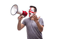 Scream on megaphone Englishman football fan in game supporting of England Royalty Free Stock Photos