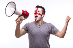 Scream on megaphone Englishman football fan in game supporting of England national team Stock Photos