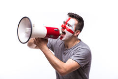 Scream on megaphone Englishman football fan in game supporting of England national team Royalty Free Stock Photography