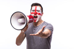 Scream on megaphone Englishman football fan in game supporting of England national team Royalty Free Stock Images