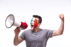 Scream on megaphone Italian football fan in game supporting of Italy national team Stock Photos