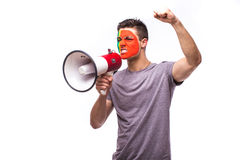 Scream on megaphone Portuguese football fan in game supporting of Portugal national team Stock Photos