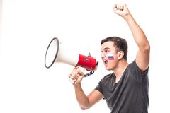 Support Russia. Scream on megaphone Russian football fan in game supporting of Russia national team on white background. Football. Scream on megaphone Russian stock photography