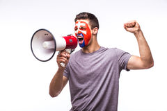 Scream on megaphone Slovak football fan in game supporting of Slovakia national team Royalty Free Stock Image