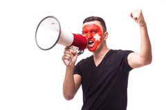 Scream on megaphone Turk football fan in game supporting of Turkey Royalty Free Stock Image