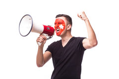 Scream on megaphone Turk football fan in game supporting of Turkey Stock Photos