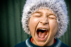 Scream of one excited creazy angry kid royalty free stock image