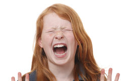Scream. Portrait of a screaming young girl on white background Stock Photography