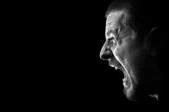 Scream of rage - angry furious evil mad man. Angry man screaming in extreme rage Stock Image