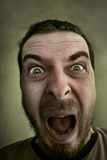 Scream of shocked scared man. Screaming loud - Absolutely shocked and outraged guy Stock Photo
