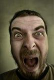 Scream of shocked scared man Stock Photo