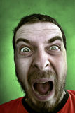 Scream of shocked spooky man. Portrait of shouting shocked man with big and fearful eyes Royalty Free Stock Images