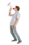 Screamimg young man holding megaphone Stock Images