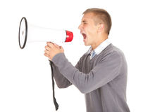 Screamimg young man holding megaphone Stock Image