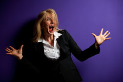 Screaming. Business woman on a purple wall Royalty Free Stock Images