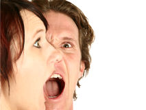 Screaming. Man and woman screaming.  Focus on man's face Royalty Free Stock Photography