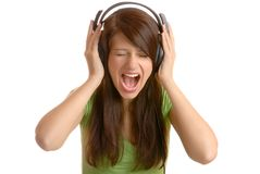 Screaming. Girl listening to the music and screaming Stock Image