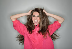 Screaming aggressive brunette woman Royalty Free Stock Photography