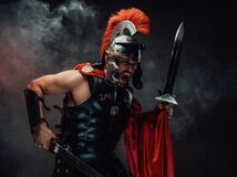 Free Screaming And Savage Roman Warrior With Swords And Armour Stock Images - 199988484