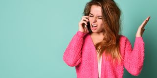 Screaming angry woman on the mobile phone royalty free stock image