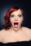 Screaming attractive redhead woman Stock Photography