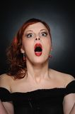 Screaming attractive redhead woman Stock Image