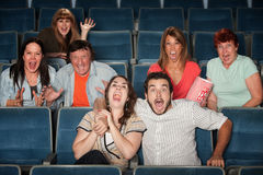 Screaming Audience. Group of seven scared people screaming in a theater Royalty Free Stock Images