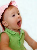 Screaming baby girl. A cute baby girl in sun hat screaming with mouth open (9 months old Stock Photography