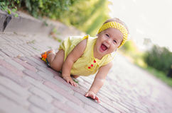 Screaming baby girl. On the track in the park royalty free stock photos