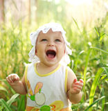 Screaming of baby lost in meadow Stock Photos