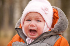 Screaming baby stay in forest Stock Photo