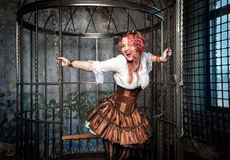 Screaming beautiful steampunk woman in the cage Stock Photography