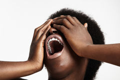 Screaming black woman. On a white Stock Image
