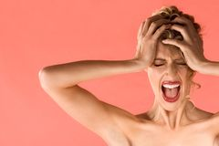 Screaming blond beautiful woman with shut eyes Royalty Free Stock Image