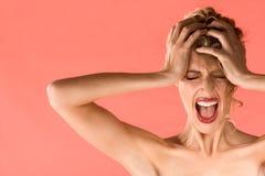 Screaming blond beautiful woman with shut eyes royalty free stock image