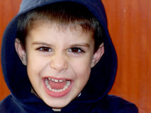SCREAMING BOY. Portrait of emotionally kid, close-up stock photos