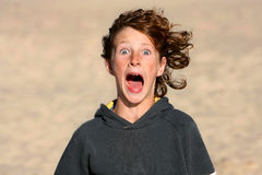 Screaming boy. With curly hair Stock Photos