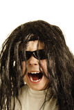 Screaming boy in wig Stock Photography