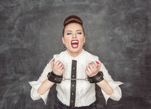 Screaming business woman with handcuffs on her hands Royalty Free Stock Images