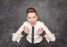Screaming business woman with handcuffs on her hands Stock Photos
