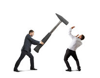 Screaming businessman holding big hammer Royalty Free Stock Photography