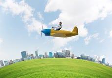 Screaming businessman in leather helmet flying stock illustration