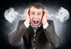 Screaming businessman looking at camera Stock Images