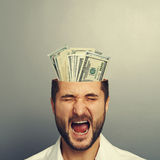 Screaming businessman with money Stock Image