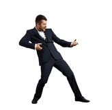 Screaming businessman pulling invisible rope Stock Photo