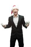 Screaming businessman in santa hat holding money Stock Photography