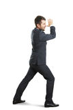 Screaming businessman striding Stock Photo