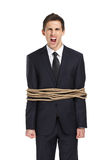 Screaming businessman tied with the rope Stock Photo