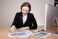 Screaming businesswoman with financial report Royalty Free Stock Photography