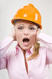 Screaming businesswoman in helmet Royalty Free Stock Photo
